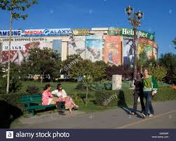 bucharest shopping centre stock photos bucharest shopping centre bucharest romania unity square young women sitting on a park bench stock