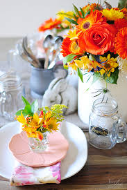 a spring table setting with everyday objects