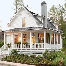i sooooo want an farm style house with a porch all the way