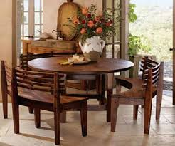 breakfast table with curved wooden benches when i wander
