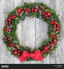 traditional christmas wreath with red bow bauble decorations