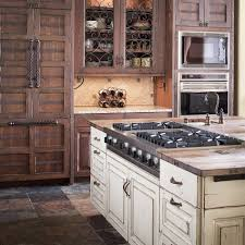 travertine countertops white distressed kitchen cabinets lighting