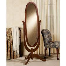 decorating rectangle black cheval mirror with area rug and cream