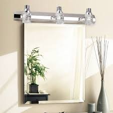 one below with lighting above 2 mirrors centered over each sink