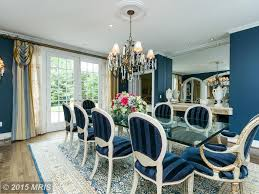 traditional blue dining room design ideas pictures zillow digs traditional dining room with high ceiling chandelier crown molding henredon arabesque dining chair