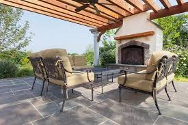 massive outdoor fireplace with free standing pergola and furniture