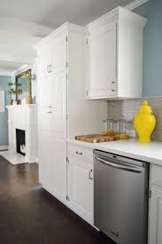 white kitchen cabinets with wood crown molding how to add crown molding to the top of your cabinets