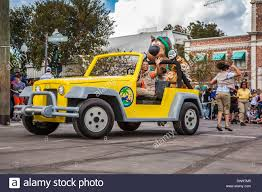 jeep cartoon offroad black woman driving jeep vehicle with cartoon characters in parade