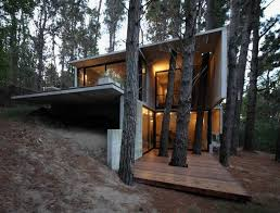modern concrete house in the midst of trees franz house home