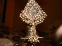 this is known as challa its an silver ornament n also used as a