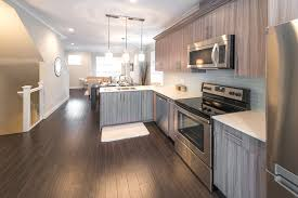 kitchen with light wood cabinets light hardwood floors with dark kitchen cabinets white kitchen