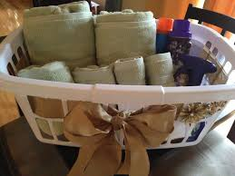 bridal shower gift laundry basket filled with towels detergent