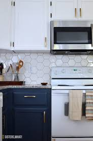 two tone kitchen cabinet ideas a two toned diy kitchen remodel with hexagon tiles sisters what
