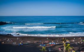 where on earth to find a black sand beach travel leisure