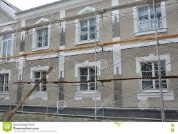 painting stucco and plastering exterior house scaffolding facade