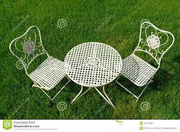 cast iron patio furniture sets cast iron patio furniture set on green grass stock photos image