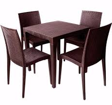 plastic round table and chairs branded rattan design dining set black with armless chairs 4 1
