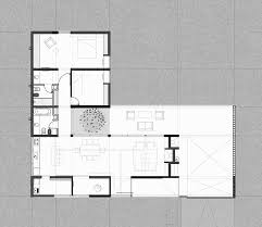 Concrete House Floor Plans House By Tectum Features Raw Concrete Walls And Black Metal
