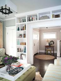 bookcase white built ins around stone fireplace white built in