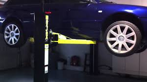 Low Ceiling 2 Post Lift by Maxjax 2 Post Auto Lift In Home Garage Lifting And Lowering Audi