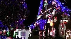 house decorated with colorful christmas lights for christmas