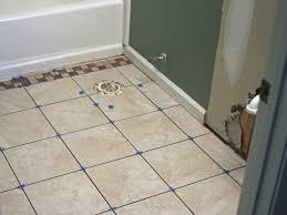dark wood effect porcelain floor tiles laid in a herringbone