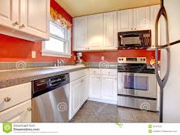 Red Kitchen White Cabinets White Kitchen Cabinets With Bright Red Wall Stock Photo Image