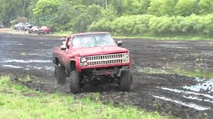 1977 Ford Truck Mudding - red pickup truck gets stuck mudding at stampers mud bog youtube