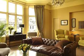 comfy soft brown sofa with black and white curtain and delightful