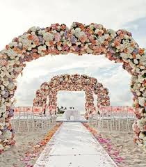 wedding arches flowers bahamas wedding with three arches of flowers by tracey