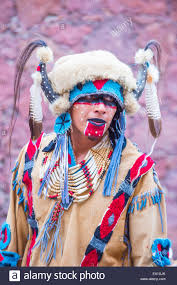 native american with traditional costume participates at the
