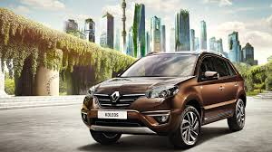 renault koleos 2015 brown renault koleos car on city background wallpapers and images