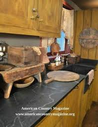Central Kentucky Log Cabin Primitive Kitchen Eclectic Kitchen Louisville By The - the workshops of david t smith hidden garbage can my country