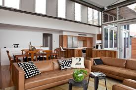 caramel leather sofa used to transitional living room with metal
