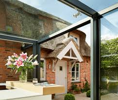 18th century thatched roof english cottage renovated with glass