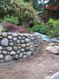 what is the proper procedure to build a rock wall the home