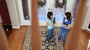 Banister Clips Two Teenage Girls Standing In A Foyer Engaged In Conversation Stop