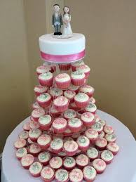 cupcake wedding cake wedding cake toppers crafted by atop of the tier cupcake