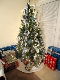tree decorations with white ribbons happy holidays