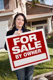happy attractive hispanic woman holding for sale by owner real