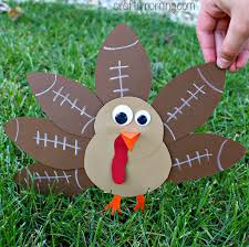 how to make a turkey out of a pine cone football turkey craft for kids to make crafty morning