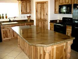 curved brown wooden kitchen island with white countertop and brown