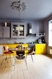 modern gray yellow kitchen slide in range and vases cabinets