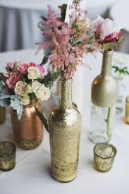 wine bottle wedding centerpieces only make them sparkly silver bottles as flower vases and