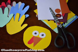give him a hand paper plate turkey kid craft glued to my crafts