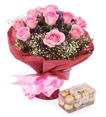 a dozen roses a dozen roses with a box of ferrero rocher chocolates shamuns