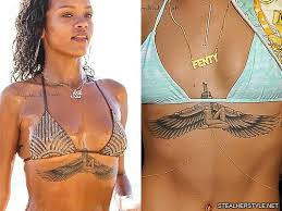 rihanna s tattoos meanings style