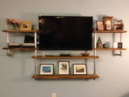 diy entertainment center using plumbing pipe and the top of a