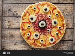 Traditional Halloween Monsters Halloween Scary Food Monster Pizza With Eyes On Vintage Wooden