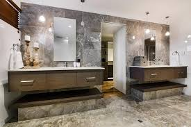 modern bathroom with two sinks and frameless mirrors also lovely